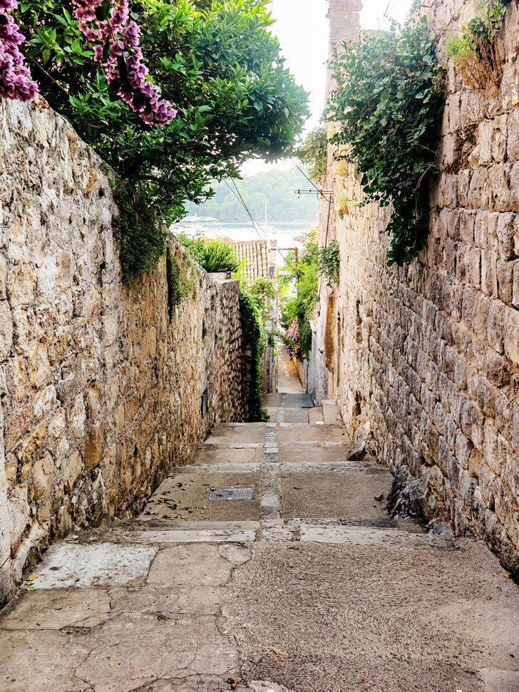 Explore the flower-filled backstreets of Cavtat, Croatia.