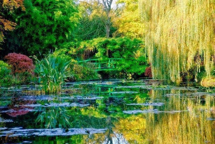 The famous Japanese Bridge over the waterlily pond in Monet's Garden at Giverny, France