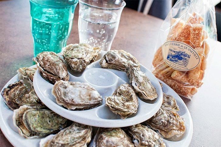 Oysters fresh from the sea are just one of the best Normandy foods you can enjoy.