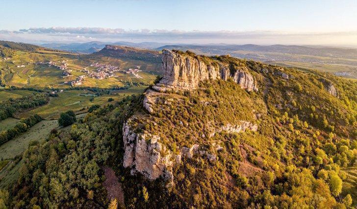 Aerial view of Solutre rock in Burgundy at sunrise, France