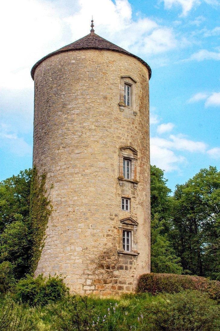The historic tower of Clairvaux-les-Lacs in Jura, France.